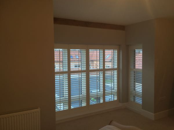64mm louvre plantation shutters in Silk White